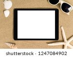 tablet on the beach sand  blank ... | Shutterstock . vector #1247084902