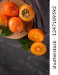 ripe persimmon fruits in a cork ... | Shutterstock . vector #1247109592