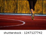 red running track with runner's ... | Shutterstock . vector #1247127742
