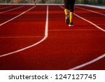 red running track with runner's ... | Shutterstock . vector #1247127745