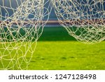 green football field in stadium | Shutterstock . vector #1247128498