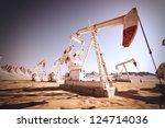 oil pump jack rocking. | Shutterstock . vector #124714036