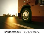 large delivery truck is moving... | Shutterstock . vector #124714072