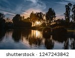 lake at sunset with colorful sky | Shutterstock . vector #1247243842