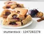 plum cake cut in triangle shape ... | Shutterstock . vector #1247282278