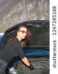 young beautiful girl trying to...   Shutterstock . vector #1247285188