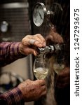 old winemakers hands pouring a...   Shutterstock . vector #1247293675