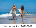 young couple walking on beach... | Shutterstock . vector #124730002