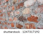 old obsolete red brick wall... | Shutterstock . vector #1247317192