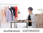 beautiful young stylist working ... | Shutterstock . vector #1247353252