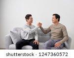sealing a deal  two happy men... | Shutterstock . vector #1247360572