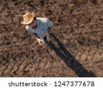 Top View Of Male Farmer Flying...