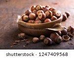 heap hazelnuts with broken... | Shutterstock . vector #1247409568