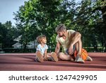 father and son on the... | Shutterstock . vector #1247429905
