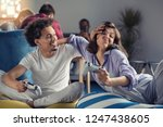 couple playing video games at... | Shutterstock . vector #1247438605