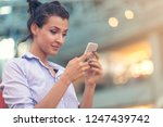 young woman busy with calling ... | Shutterstock . vector #1247439742