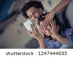 attractive couple sitting on... | Shutterstock . vector #1247444035