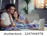 young couple watching a movie... | Shutterstock . vector #1247446978