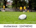 Постер, плакат: Rugby ball at green