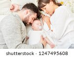 mother and father as happy... | Shutterstock . vector #1247495608
