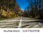 empty road leading to mountains ... | Shutterstock . vector #1247502958