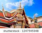 the golden giant standing guard ... | Shutterstock . vector #1247545348
