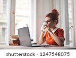 young woman working and having... | Shutterstock . vector #1247548075