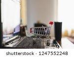 shopping cart on computer... | Shutterstock . vector #1247552248