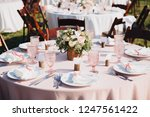 banquet wedding tables are in... | Shutterstock . vector #1247561422