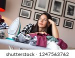 young bored and tired woman... | Shutterstock . vector #1247563762