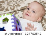 Adorable Baby Is Playing on the carpet - stock photo