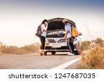 asian women the car is broken... | Shutterstock . vector #1247687035
