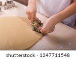 cut cookies using the cookie... | Shutterstock . vector #1247711548