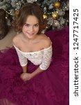 beautiful brunette girl sitting ...   Shutterstock . vector #1247717425