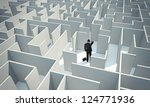 a businessman stands in the... | Shutterstock . vector #124771936