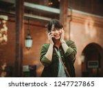 asian woman using smartphone...   Shutterstock . vector #1247727865