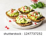 avocado feta pomegranate toasts ... | Shutterstock . vector #1247737252