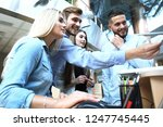group of young people in casual ... | Shutterstock . vector #1247745445