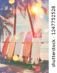 surfboard and palm tree on... | Shutterstock . vector #1247752528