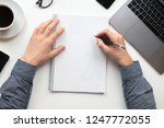 man writing on notebook in the... | Shutterstock . vector #1247772055