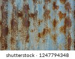rusty on old corrugated metal... | Shutterstock . vector #1247794348
