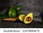delicious avocados in a cork... | Shutterstock . vector #1247800672