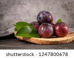 delicious red plums in a cork... | Shutterstock . vector #1247800678