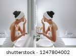 woman wrapped in towel applying ... | Shutterstock . vector #1247804002