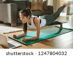 smiling woman exercising at... | Shutterstock . vector #1247804032