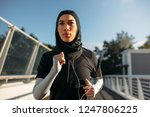 healthy sporty woman wearing... | Shutterstock . vector #1247806225