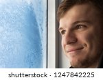 a young handsome man looks at...   Shutterstock . vector #1247842225