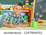 Cute Little Boy Drawing With...