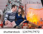 young  couple with gifts near... | Shutterstock . vector #1247917972