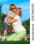 happy mother with son in the... | Shutterstock . vector #1247964292